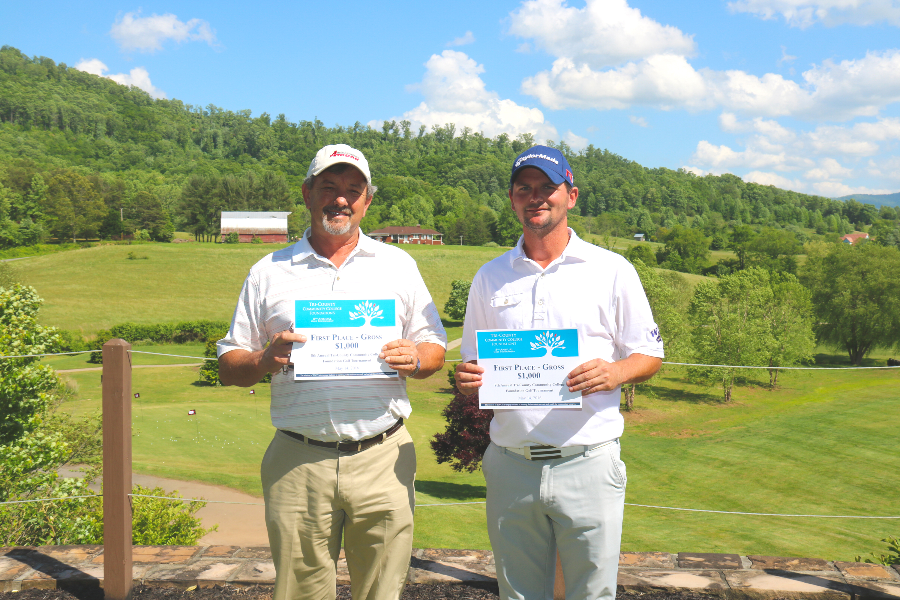 Rick Curtis and Matt Cook, winners of the $1,000 first place gross prize pose with their winnings at the TCCC Foundation's 8th Annual Golf Tournament at The Ridges Country Club in Hayesville on May 14.