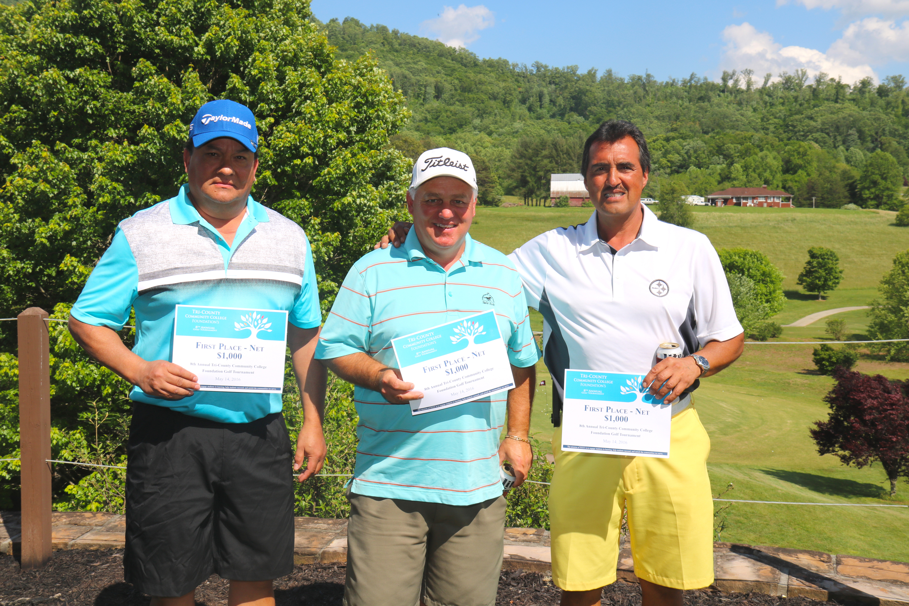 Marty Taylor, Jim Owle, and Tommy Bradley, winners of the $1,000 first place net prize pose with their winnings at the TCCC Foundation's 8th Annual Golf Tournament at The Ridges Country Club in Hayesville on May 14.