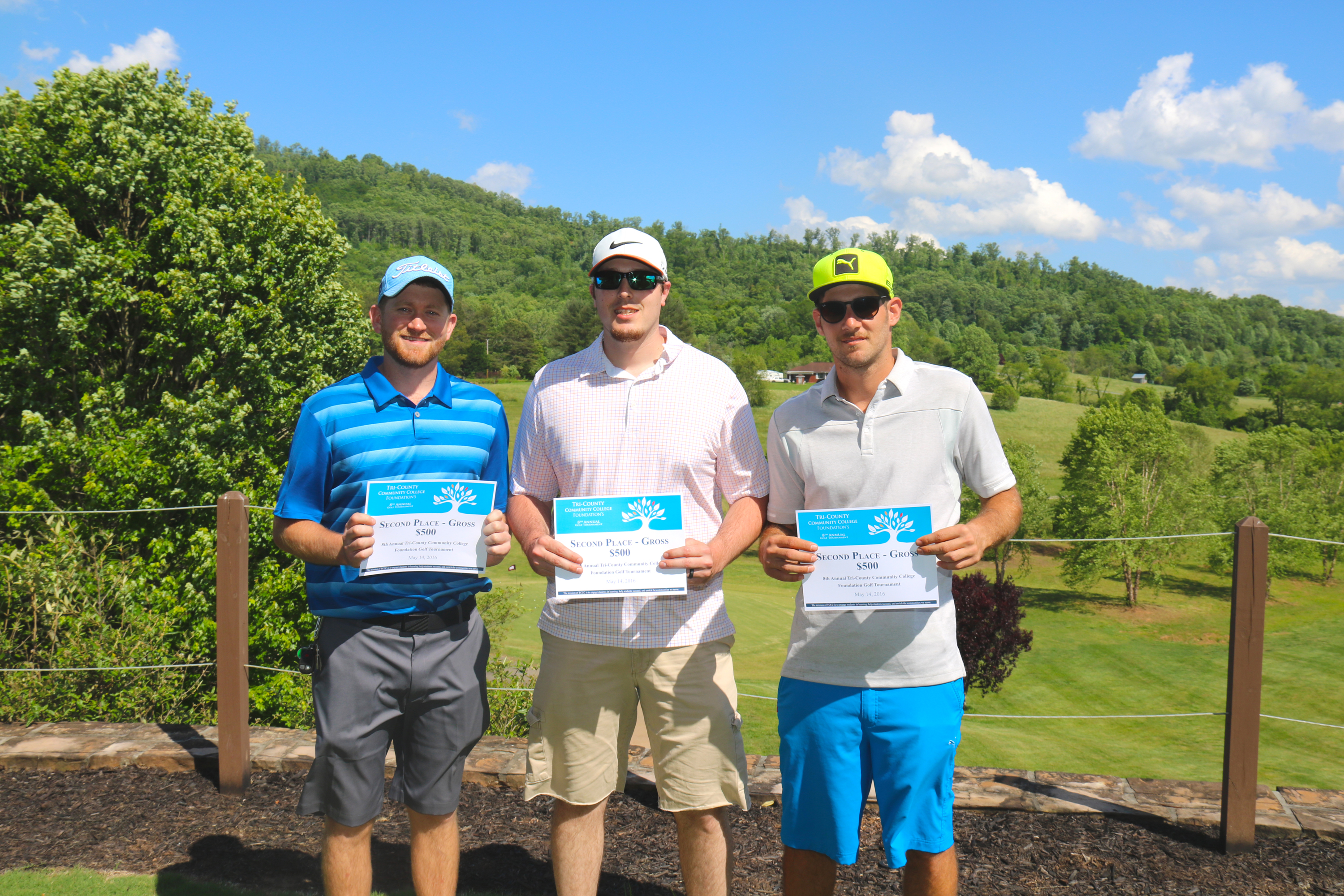 Second place gross $500 prizewinners, Levi Zimmerman, Cort McKeon, and Jesse Puccio, pose with their winnings at the TCCC Foundation's 8th Annual Golf Tournament at The Ridges Country Club in Hayesville on May 14.