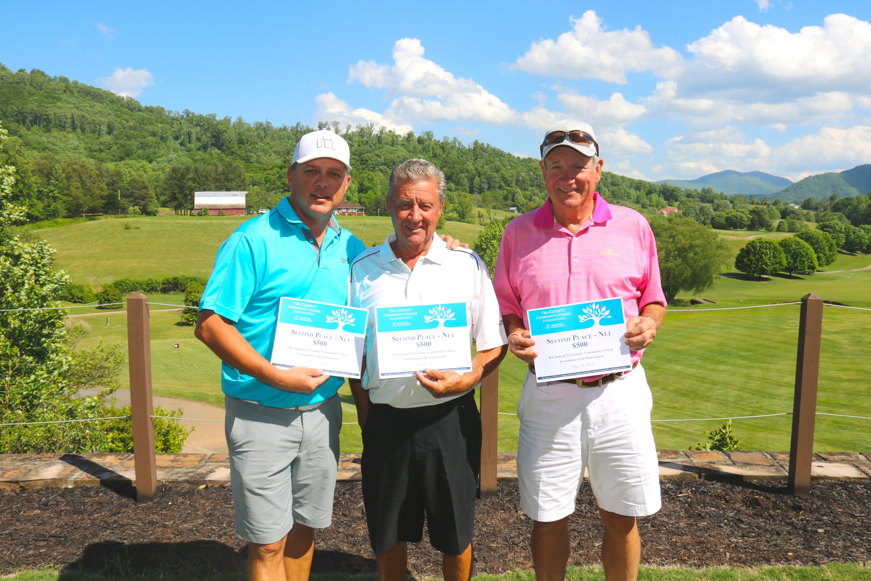 Larry Owens, Jason Brooks, and Tom Erwin, winners of the $500 second place net prize, pose with their winnings at the TCCC Foundation's 8th Annual Golf Tournament at The Ridges Country Club in Hayesville on May 14.