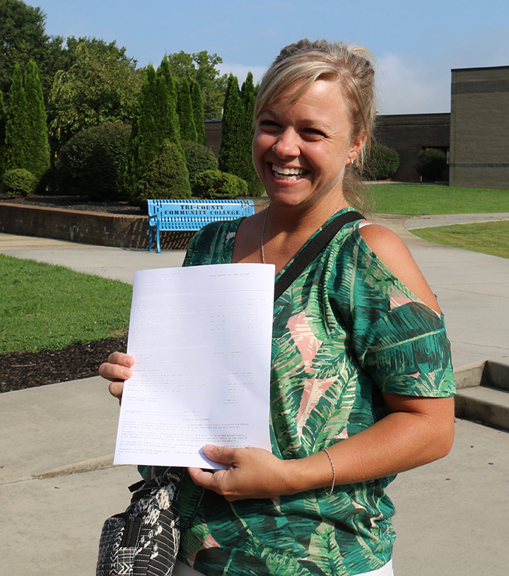 Jessica Aldrich poses at the main campus with her registration worksheet after selecting her classes for the fall semester last August.