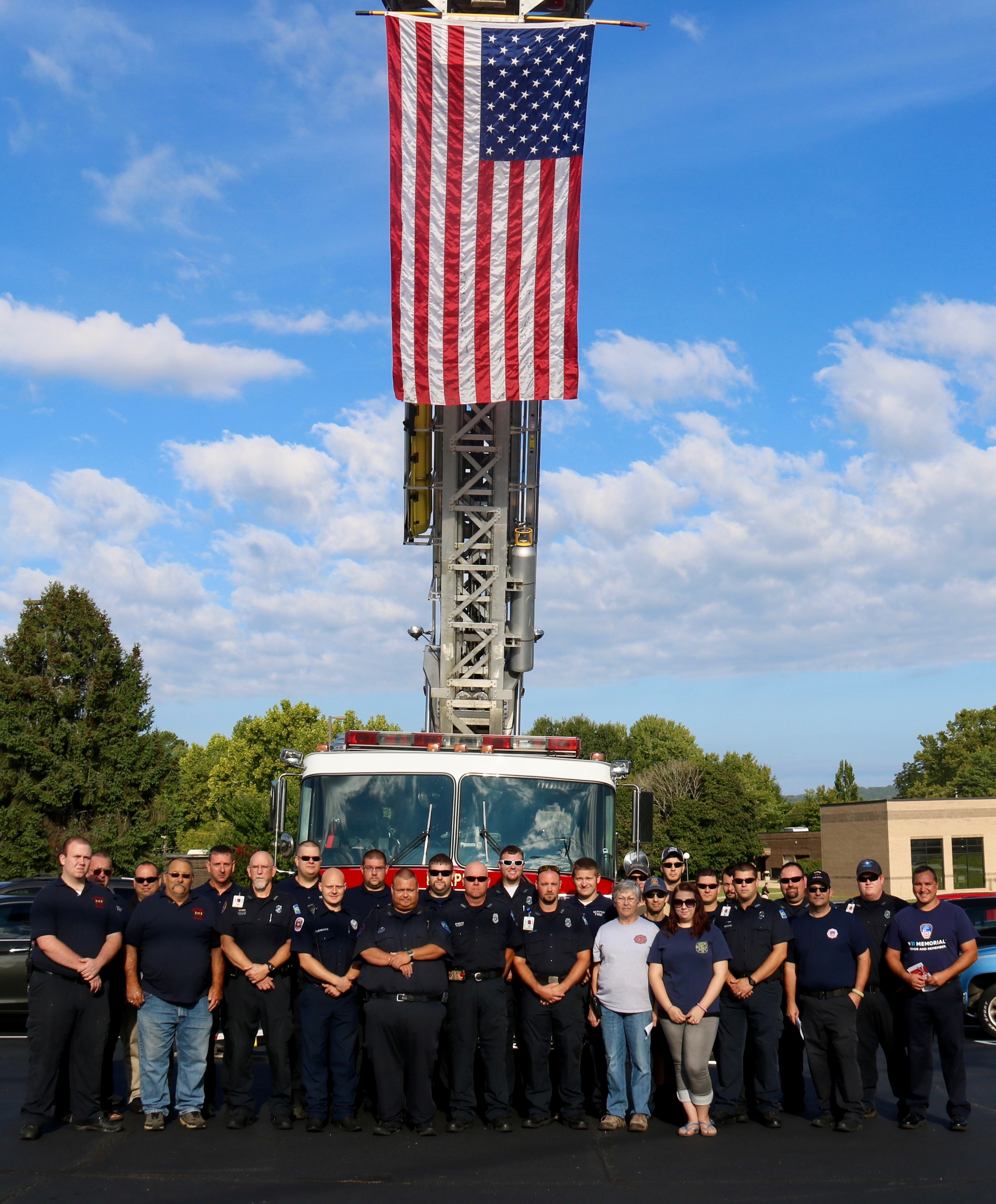 Representatives from a variety of local public safety departments pose at Tri-County Community College during a previous Patriot Day Memorial Ceremony.