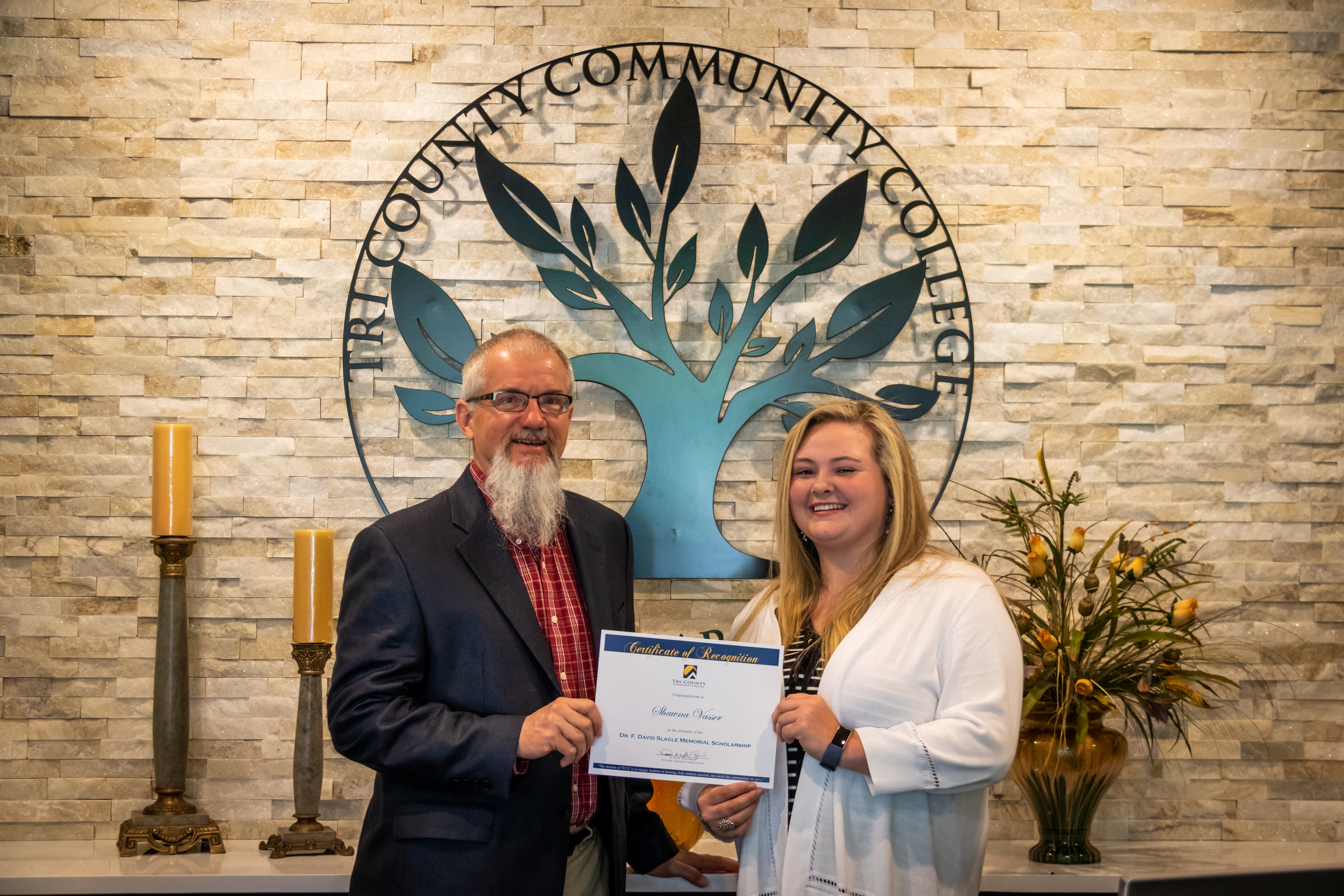 Cutline: (from left) Bo Gray, executive director of the Tri-County Community College Foundation, awards the inaugural Dr. F. David Slagle Memorial Scholarship to Shawna Vasser at the main campus in Peachtree.